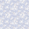 Seamless pattern with flowers small and leaves on a blue background Royalty Free Stock Images