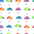 Seamless pattern with fresh bright watercolor umbrellas.