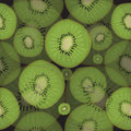 Seamless pattern of fresh kiwi fruit on a black background. Hand drawn style. Summer colorful background