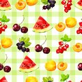 Seamless pattern with summer berries of watermelon, red and black currant, apricot and cherry on a checkered green background