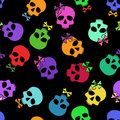 Seamless pattern of funny cartoon skulls colorful on a black background Royalty Free Stock Photography