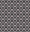 Seamless pattern with geometric zigzag and small flowers. Abstract black and white floral texture. Simple monochrome