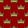 Seamless pattern of golden crowns depicting royalty on a brown background vector illustration Royalty Free Stock Photos
