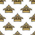 Seamless pattern of golden royal background ornate crowns on a white background Royalty Free Stock Photos