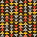 Seamless pattern with golden and silver glittering triangles. Gold geometrical repeatable pattern on brown background. Can be used