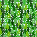 Seamless pattern with green silhouettes of fir-trees and pines. Winter forest background with snowfall.