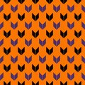 Seamless pattern in Halloween traditional colors with arrows motif. Repeated mini brackets. Simple print with pointers