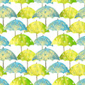 Seamless pattern with hand drawn blue and green umbrellas with white circles on white background