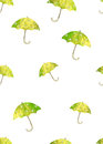 Seamless pattern with hand drawn green umbrellas with white circles on white background