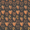 Seamless pattern of hand painted hearts on a grungy background Stock Images