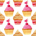 Seamless pattern with hand painted watercolor cupcakes with hearts and sweet cherries. Vector background with pink colorful cakes.