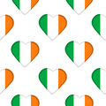 Seamless pattern from the hearts with Ireland flag.