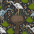 Seamless pattern with heron bird, old tree, nest and swamp plants. Marsh flora and fauna. Royalty Free Stock Photo