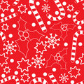 Seamless pattern with hollies and candycanes Stock Images