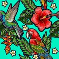 Seamless pattern with humming bird, hibiscus flowers and tropical leaves.