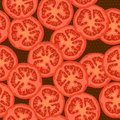 Seamless pattern with the image of the round sliced tomatoes.