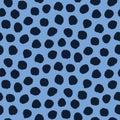 Seamless pattern. Indigo blue hand drawn imperfect polka dot spot shape background. Monochrome textured dotty ink circle