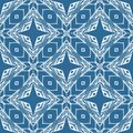 Seamless pattern with lace white ornament on blue background. Print for fabric, textile, wrapping paper, wallpaper