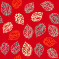 Seamless pattern with leaves on red background