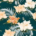 Seamless pattern, light vintage colors palm leaves and hibiscus flowers on darck green background. Royalty Free Stock Photo