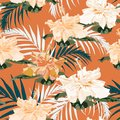 Seamless pattern, light vintage colors palm leaves and hibiscus flowers on light brown background. Royalty Free Stock Photo