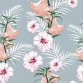 Seamless pattern, light vintage colors palm leaves and hibiscus. tropical lilies flowers on vintage blue background. Royalty Free Stock Photo
