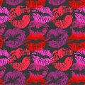 Seamless pattern with lipstick kisses. Colorful lips imprints of red purple and pink shades isolated on a black