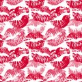 Seamless pattern with lipstick kisses. Lips imprints of red and pink shades isolated on a white background. Endless
