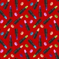 Seamless pattern with lipsticks and lip prints on red background.