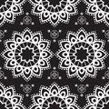 Seamless pattern mehndi background with flowers in indian style with lace buta decoration items on black background. Royalty Free Stock Photo