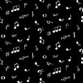 Seamless pattern with music notes symbols. Black background.
