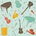 Seamless pattern with musical instruments and note symbols Royalty Free Stock Photo