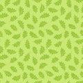 Seamless pattern. Oak leaves on a light green background. It can