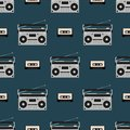 Seamless pattern with old boomboxes and tape cassettes. Vintage music print. Retro vector illustration.