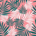 Seamless pattern with palm leaves on a pink background.