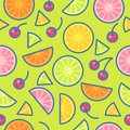 Seamless pattern. Pieces of oranges, limes, lemons and cherries on a green background. Royalty Free Stock Photo