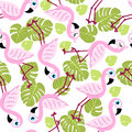 Seamless pattern with pink flamingos and green palm leaves