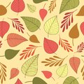 Seamless pattern with pink,orange,brown and green leves on a beige background