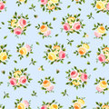 Seamless pattern with pink, orange and yellow roses on blue. Vector illustration. Royalty Free Stock Photo