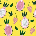 Seamless pattern of pink pitaya and grapes on a bright yellow background.