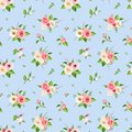 Seamless pattern with pink and white flowers on blue. Vector illustration. Royalty Free Stock Photo