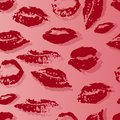 Seamless pattern with a print of female lips