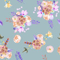 A seamless pattern with purple flowers, leaves, feathers, arrows and branches
