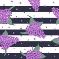 Seamless pattern with purple lilac flowers on a striped background Royalty Free Stock Photo