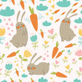 Seamless pattern with rabbits and carrots cute vector flowers clouds for your design Royalty Free Stock Photography
