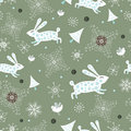Seamless pattern of rabbits and snowflakes Stock Image