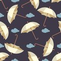 Seamless pattern with rain, leaves and colorful umbrellas . Wallpaper for children room. Weather background