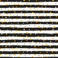 Seamless pattern of random gold dots