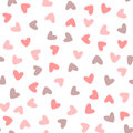 Seamless pattern with randomly scattered hearts drawn by hand.