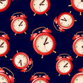 Seamless pattern with red alarm clock on blue background Royalty Free Stock Photo